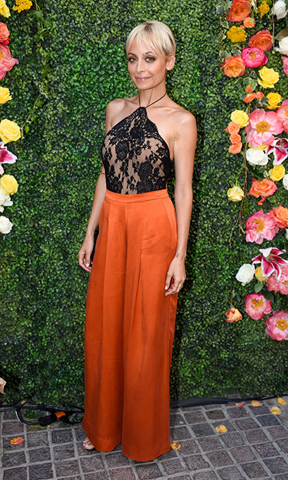 Nicole Richie showed off a straight '70s vibe in a vintage-inspired lace halter top and silk wide-leg pants by her own brand, House of Harlow 1960.
