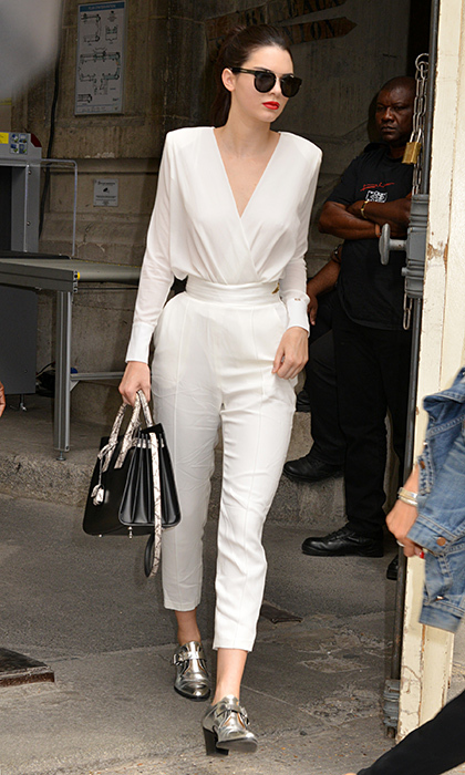 Kendall Jenner accented her all-white Chanel ensemble with buckled silver loafers and a snakeskin-accented handbag during a stroll in Paris.
