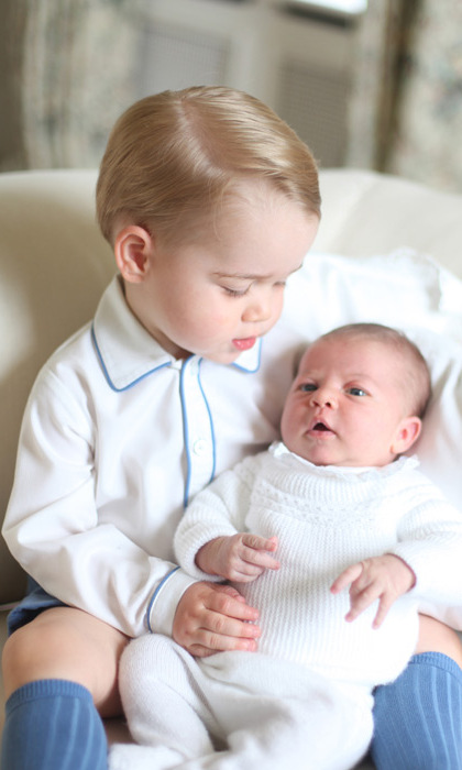 Prince George is every inch the proud big brother in a photo taken by the Duchess of Cambridge née, Kate Middleton.