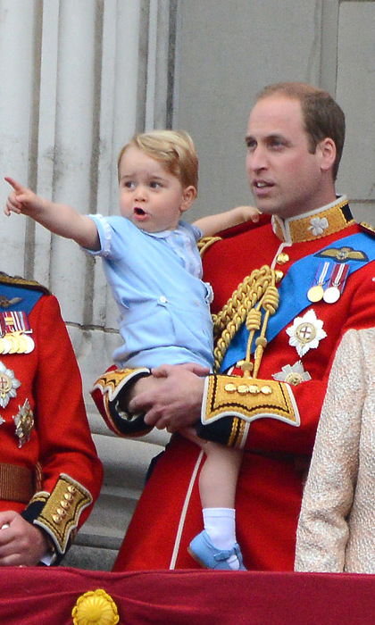 Carried by his father Prince William, the royal toddler was fascinated by the Red Arrows flypast.
