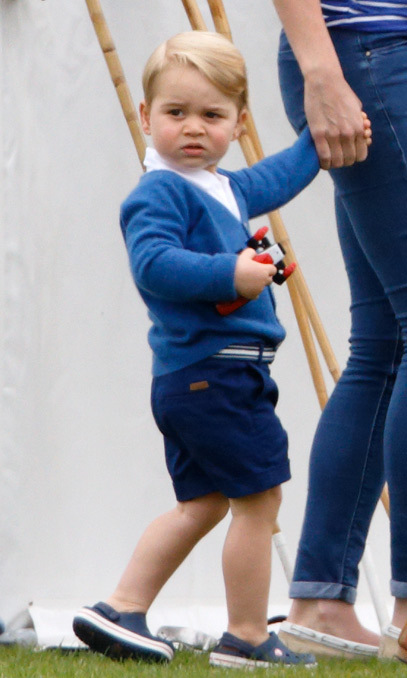 The royal toddler looked to be in his element on the the grassy slopes of the polo club.