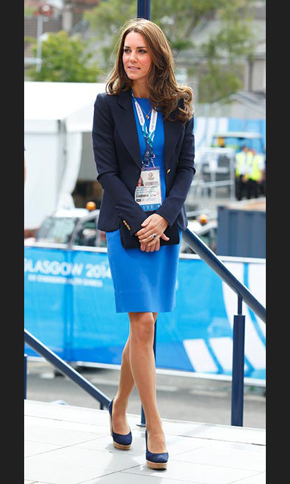 As chic as ever in a blue dress paired with a blazer and wedges as she arrived for the 20th Commonwealth games.