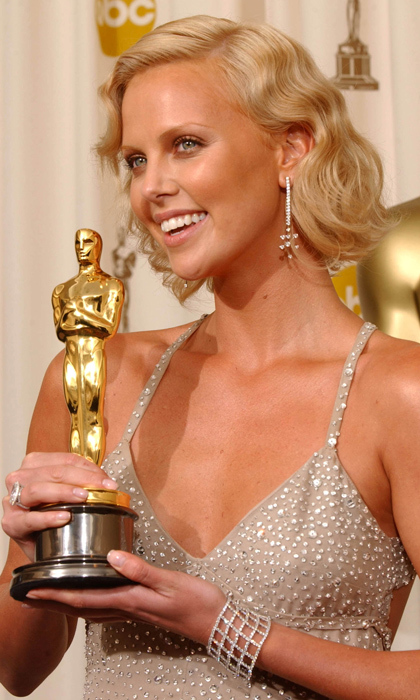Charlize glows as she holds her golden statue in a now-iconic Gucci gown by American designer Tom Ford at the 2004 Oscars. Photo: © Getty Images