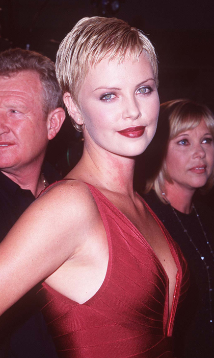 In her early red carpet days, a young Charlize wears a fitted red dress and matching crimson lip to the 1997 premiere of 'The Devil's Advocate' in Los Angeles. Photo: © Getty Images