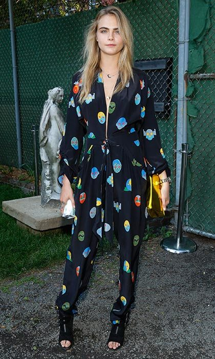 Cara was effortlessly cool at the Stella McCartney 2015 spring presentation in a quirky printed jumpsuit.