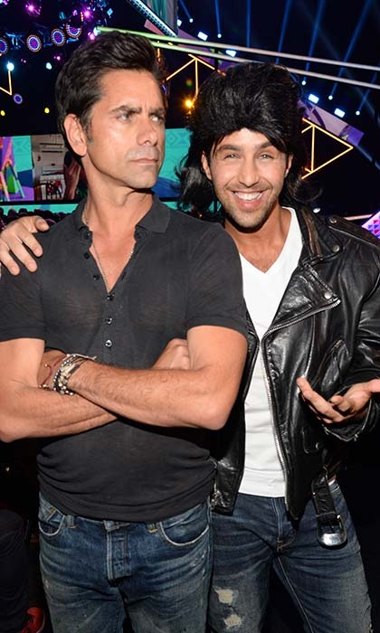Have mercy! John Stamos doesn't look very impressed by actor Josh Peck's 'Uncle Jesse' imitation at the Teen Choice Awards in LA. 