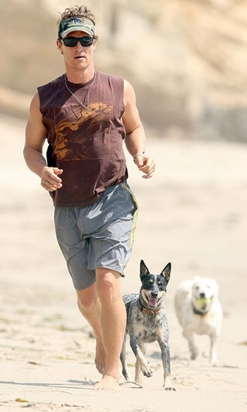 Sporty Matthew McConaughey keeps fit with his pooches by taking long runs with them on the beach.