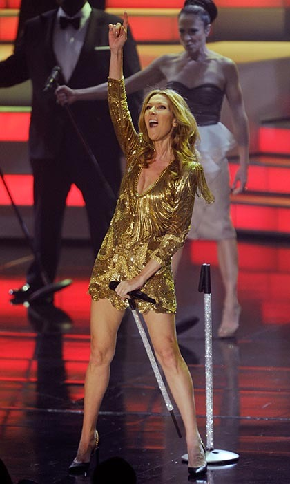 Looking gorgeous in gold, Celine rocks the Colosseum in 2011.