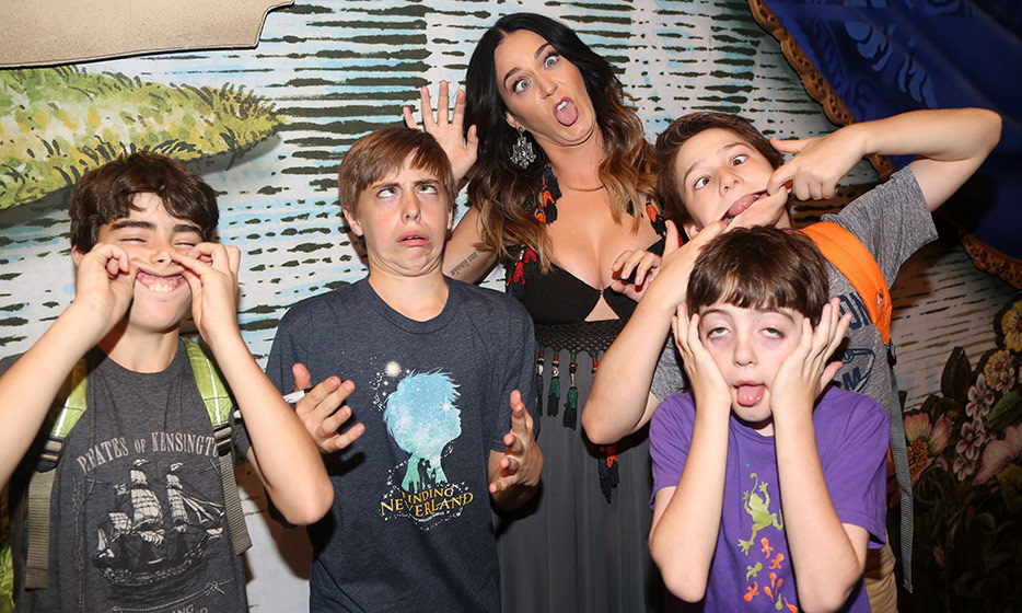 "Katy Perry goofs around with children backstage at Broadway's hit musical ""Finding Neverland."" 
