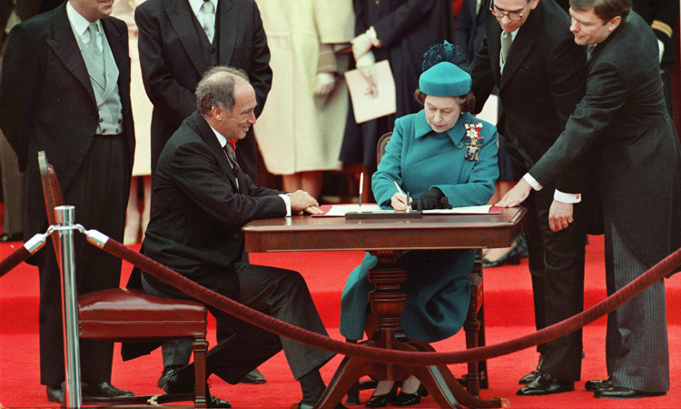 MAKING CANADIAN HISTORY, 1982: During a visit to Ottawa, the Queen sits alongside Prime Minister Pierre Trudeau to sign the Constitution Act, which repatriated Canada's constitution.