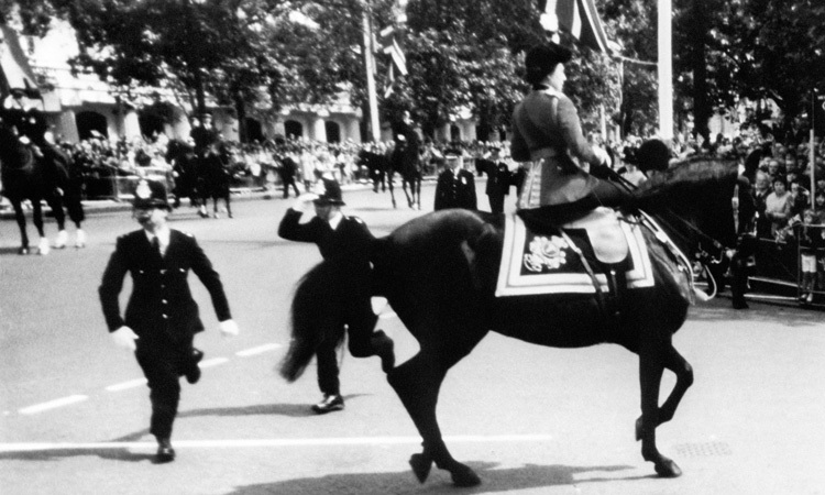 COURAGEOUS RECOVERY, 1981: In a year when both U.S. President Ronald Reagan and the Pope had been injured in assassination attempts, the Queen's calm at Trooping the Colour after six blank shots were fired impressed the world. Unharmed, she completed the ceremony. A 17-year-old man was arrested.