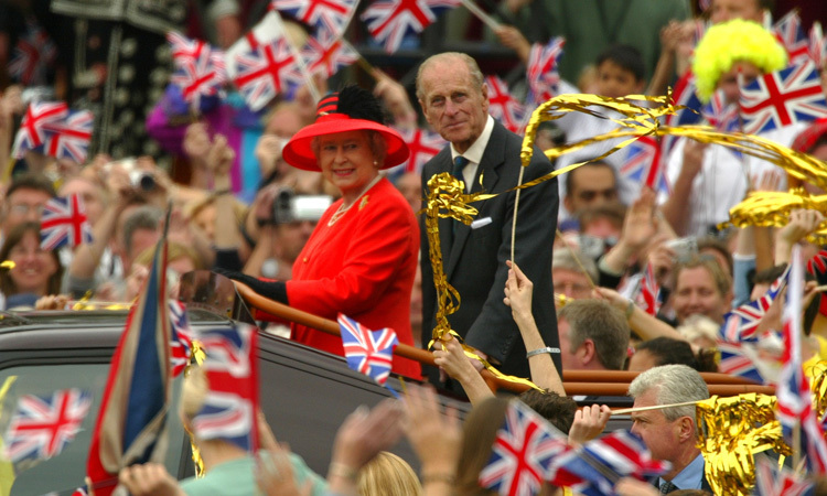 GOLDEN YEAR, 2002: After the turbulent 1990s, some thought Britain had lost faith in its monarchy, but in June 2002, the nation took to the streets again in celebration of the Queen's Golden Jubilee. The sovereign's vigorous touring schedule to mark the occasion belied her 76 years.