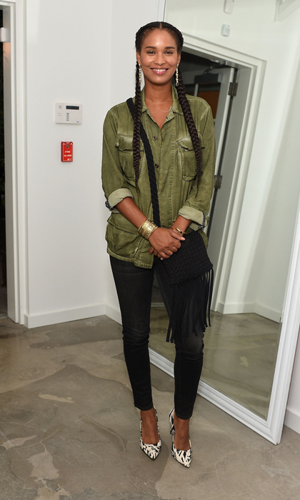 Actress Joy Bryant epitomized casual-chic in a relaxed utilitarian blouse, fringed bag and loaded gold accents.