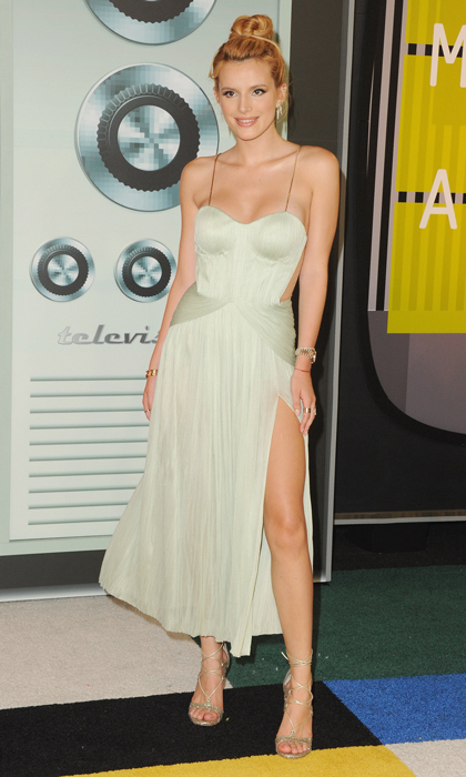 Actress Bella Thorne opted for a mature Maria Lucia Hohani design with a thigh-high slit at the MTV Video Music Awards.