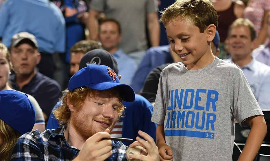 British singer Ed Sheeran takes a break from watching the New York Mets and Philadelphia Phillies baseball game to make the day of a lucky fan. 
