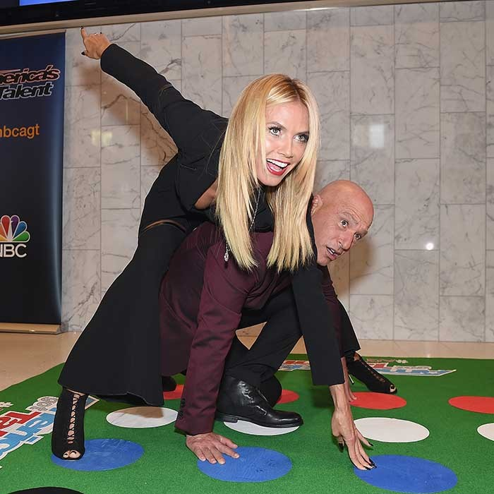 'America's Got Talent' judges Heidi Klum and Howie Mandel get twisted during a live viewing party of their hit reality competition show.  