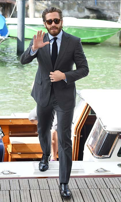Looking handsome as ever, a suited up Jake Gyllenhaal arrives by water taxi at the Venice Film Festival. 