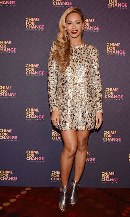 Wearing a sequinned Gucci dress for the Chime for Change concert.