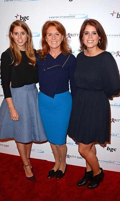 Princess Beatrice and Princess Eugenie of York with their mother Sarah Ferguson, Duchess of York.