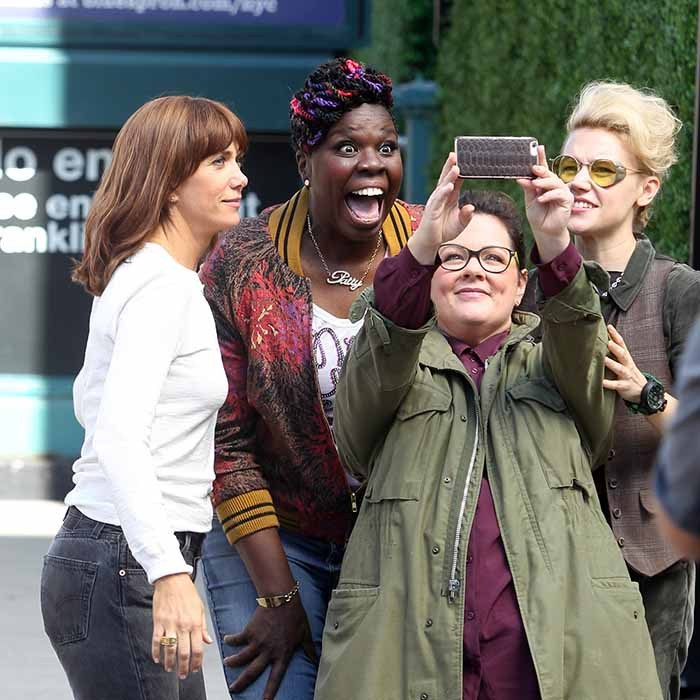 The 'Ghostbusters' (L to R: Kristen Wiig, Leslie Jones, Melissa McCarthy and Kate McKinnon) get silly while filming the reboot outside the New York firehouse featured in the original flick. 