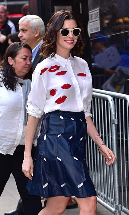 'The Intern' star Anne Hathaway shows off her lips outside the 'Good Morning America' studio in New York City.