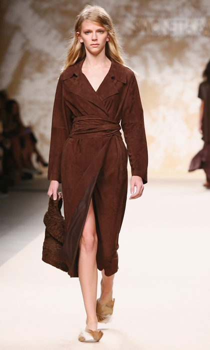 A sleek suede wrap coat, seen here on the Simonetta Ravizza runway, would lend any of Kate's favourite high street dresses a dose of luxury and sophistication.
