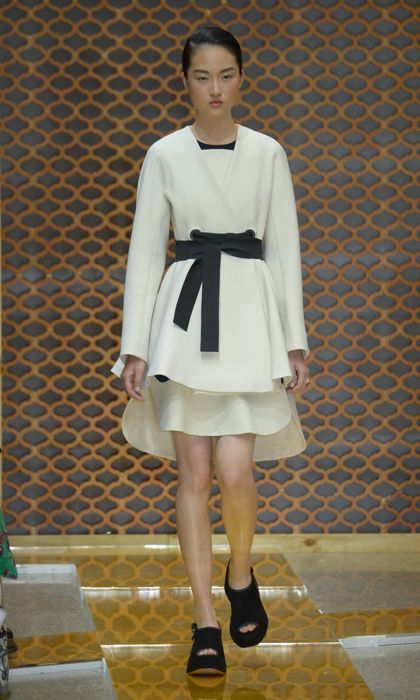 Playing with hemlines adds dimension to Sportmax's cream sheath dress and obi-belted coat, which Kate would also wear as separates.  