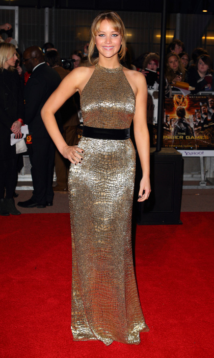'Hunger Games' heroine Jennifer Lawrence showed off her curves in metallic silver snakeskin at the film's 2012 premiere in London. 