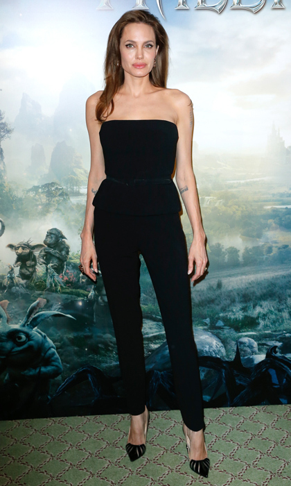 Mom-of-six Angelina Jolie looked magnificent at the 'Maleficent' premiere in Paris, wearing impeccably tailored pants and a strapless peplum top. 