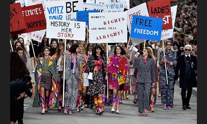 Karl Lagerfeld and Cara Delevingne led an army of models in a feminist-themed street protest on the SS15 runway.