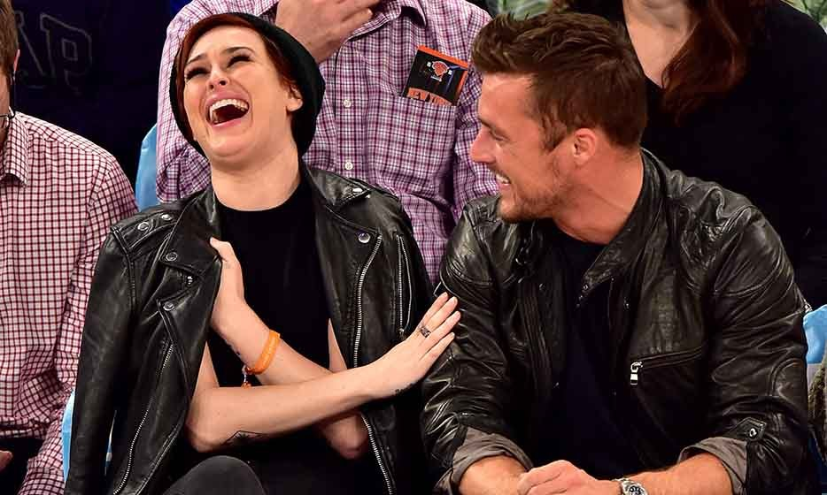 Former 'Dancing with the Stars' competitors Rumer Willis and Chris Soules have a laugh while watching the New York Knicks play an exhibition game against Brazil's Bauru team at Madison Square Garden.