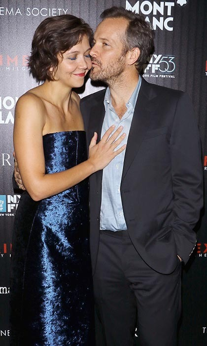 Looking more in love than ever, Maggie Gyllenhaal and her husband of six years, Peter Sarsgaard, steal a precious moment together on the red carpet at the premiere of 'Experimenter' during the New York Film Festival.
