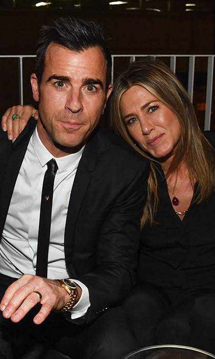 Newlyweds Jennifer Aniston and Justin Theroux share a cuddle at the after-party for the season premiere of 'The Leftovers' in Austin, Texas.