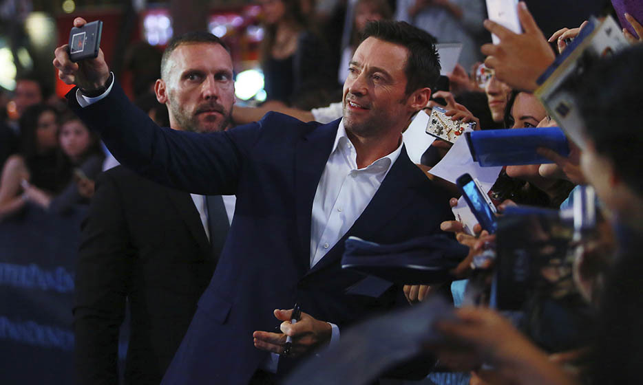 He plays a villain in 'Pan,' but Hugh Jackman is his usual charming self posing with fans outside the film's premiere in Mexico City.