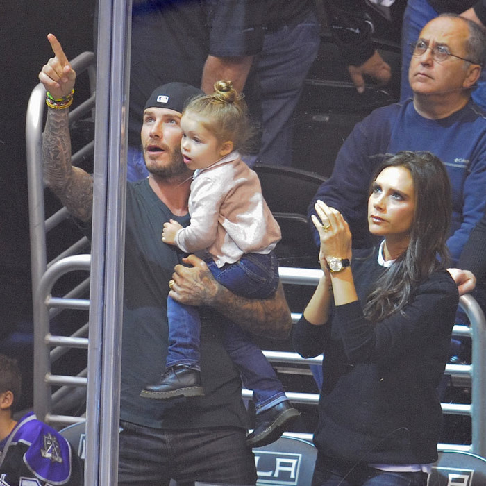 Gripped by the action as the family watch an ice hockey match in LA in 2013.