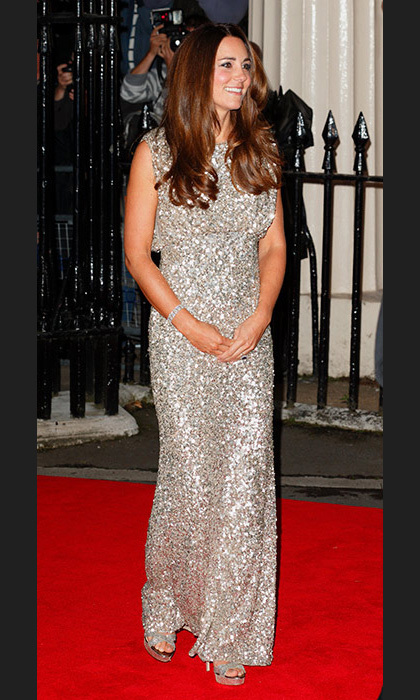 Duchess Kate made her first red carpet appearance following the birth of Prince George in style with this striking silver sequin dress from one of her go-to designers, Jenny Packham.