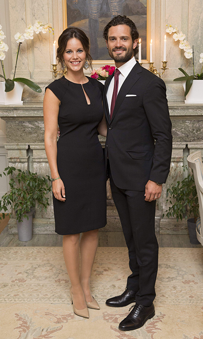 Early on in her pregnancy, Sofia showed off her petite frame in a simple LBD alongside her dapper husband, Carl Philip. 