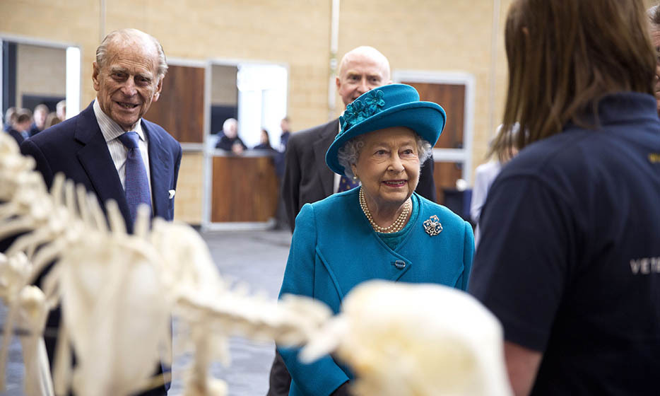 The Queen and Prince Philip listened closely as they helped to open the new School of Veterinary Medicine at the University of Surrey on Oct. 15, 2015.