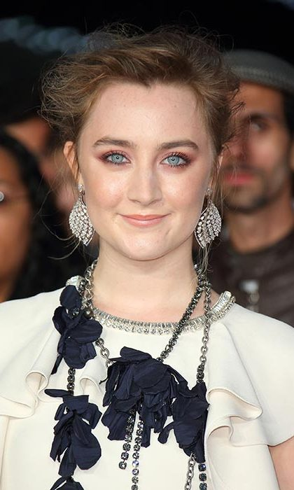Saoirse Ronan pulled out all the stops with statement glittering colourful eye make-up for the Brooklyn red carpet.