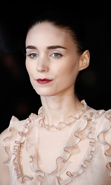 Rooney Mara channelled gothic chic with black eyeliner and a statement dark red lipstick for the Carol screening.