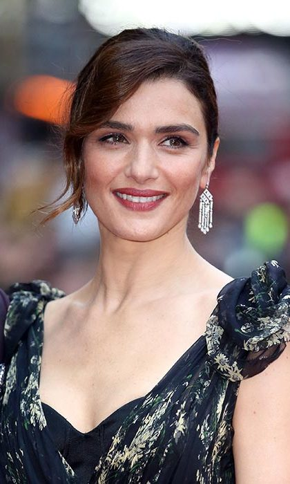 All eyes were on Rachel Weisz at The Lobster premiere as the actress wore her hair up in a sleek chignon and opted for berry lipstick, one of the season's biggest trends.
