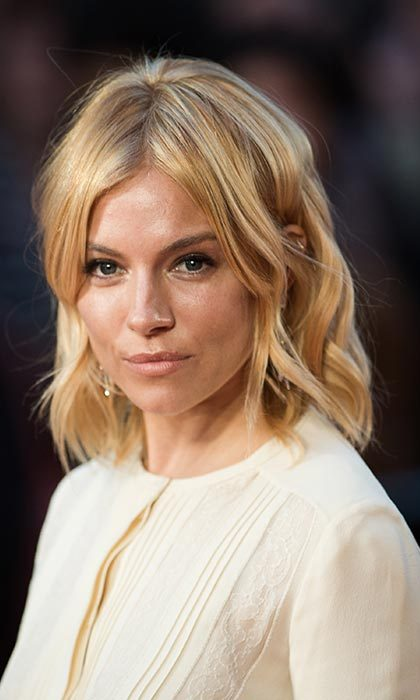 Sienna Miller was the ultimate English rose as she stepped out with her hair in tousled waves paired with barely-there make-up for the High Rise premiere.