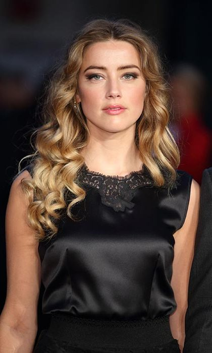Amber Heard looked every inch a beauty icon with statement curls and dramatic winged eyeliner as she joined Johnny Depp on the Black Mass red carpet.