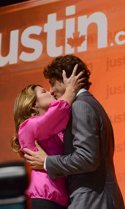 Never a couple to shy away from a tender public display, Sophie and Justin share a kiss in Sept. 2012 in his Papineau riding of Montreal - the same riding from where he gave his victory speech!
