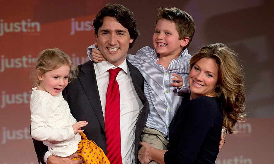 The gorgeous family is snapped in a warm embrace after Justin wins the federal Liberal leadership on Apr. 13, 2013. Xavier and Ella-Grace resume their perch in dad's arms. 