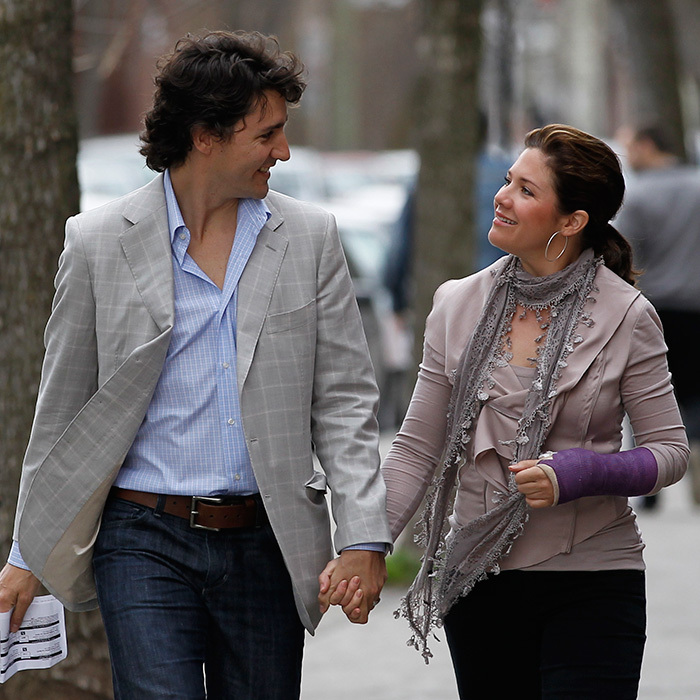 Justin and Sophie stroll hand in hand to their election office in 2011, ready to cast their votes. But first, some time to gaze adoringly at one another. 