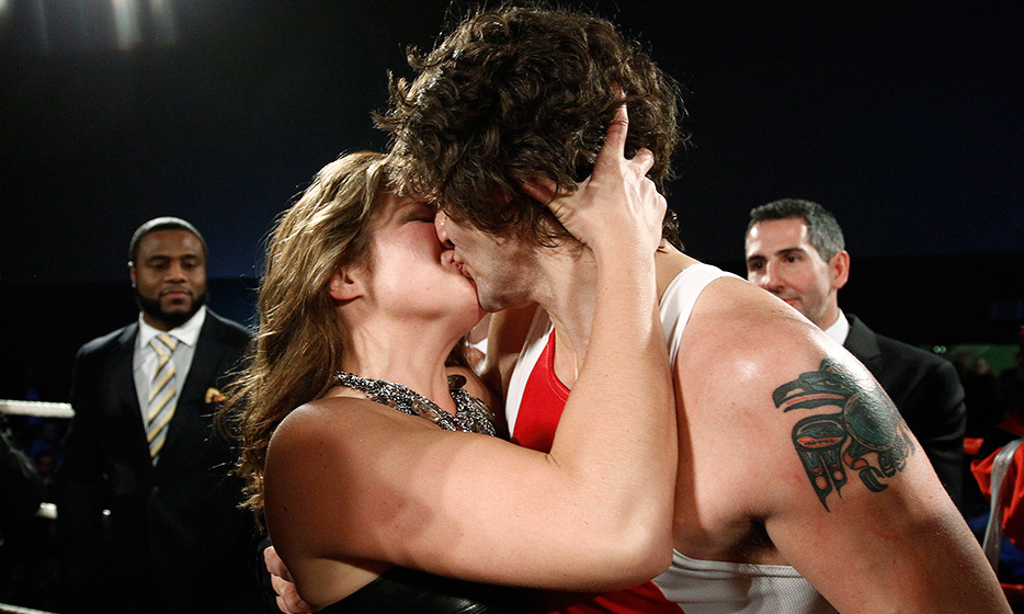 No, it's not a WWE fight - it's Justin Trudeau receiving a victory kiss from wife Sophie after defeating Conservative Senator Patrick Brazeau in a charity boxing match back in 2012.     