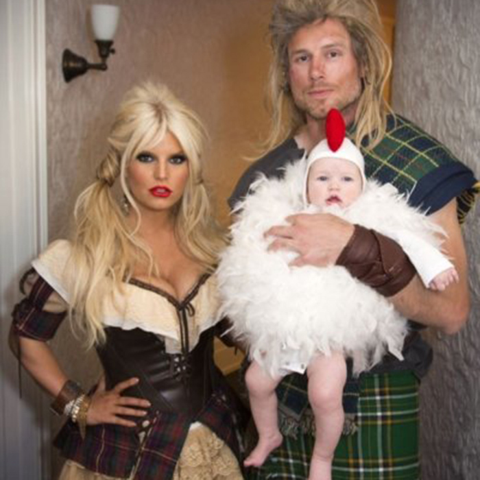 A playful blast from the past in 2012, Jessica Simpson posed as a sexy milkmaid with husband Eric Johnson her Scottish Braveheart. Their daughter, Maxwell, was the family chicken.