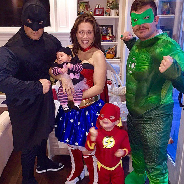 Alyssa Milano debuted her heroic family, featuring Batgirl, The Flash and Green Lantern – and, of course, her Wonder Woman alter-ego – last Halloween.