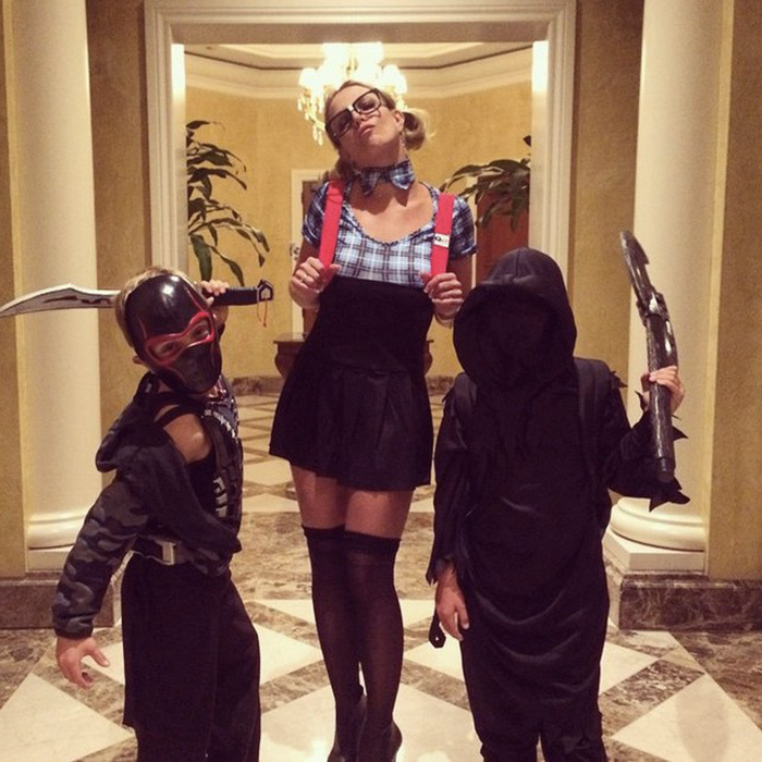 "Britney kicks it old school with a schoolgirl costume that channels her 1999 hit ""Baby One More Time,"" while sons Jayden and Sean go the ninja route in 2014.